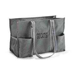 This versatile, spacious tote keeps your clutter organized! Great for your cleaning supplies or sporting gear, or use as an everyday tote or gym bag! Seven side pockets are perfect for shampoo, magazines, and water bottles. Pair me with the Fold N' File.