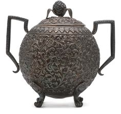 Sugar vessel, silver, Cutch. Small globular vessel standing on four short incurved legs with two handles and a lid. [...] | Horniman Museum and Gardens | CC0