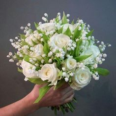 Simple Wedding Bouquet Of: White Roses, White Lily Of The Valley + Greenery