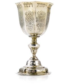 GERMAN SILVER-GILT KIDDUSH CUP vase-shaped octagonal bowl chased with strapwork below Hebrew inscriptions, on conforming baluster stem and ...