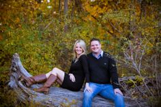 A couple lounging on a fallen tree.Copyright Photographics Solution 2012