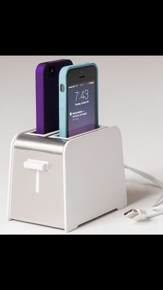 What?! Kinda want it... Also curious how many times it's been mistaken for a toaster... Foaster iPhone 5/5S/C charger toaster design charge 2 phones in the same time on Etsy