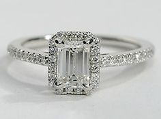 Delicate in design, this diamond engagement ring showcases micropavé-set diamonds to frame the emerald cut diamond of your choice set in enduring 14k White Gold.
