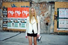 White leather vest layered with chiffon blouse and scalloped shorts.