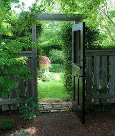 Use an old door for a gate. How good would this look if it was a Dutch door? Decorate with a wreath.