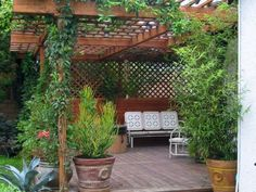 If you're dreaming of an outdoor retreat but money is tight, get some great design ideas from these porches, patios, decks and gardens.