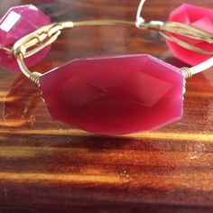 Bourbon and bow ties inspired bangle Large, maroon acrylic beads on gold wire. Size large Jewelry Bracelets