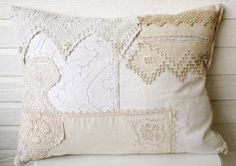 "This is a gorgeous handmade  pillow ~  It has been created with   vintage fabrics, doilies, laces,  handkerchiefs and buttons ~  It measures 19 x 26 inches ~    ""created by Bountiful"""