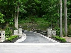 White rock border with grey pavers Driveway
