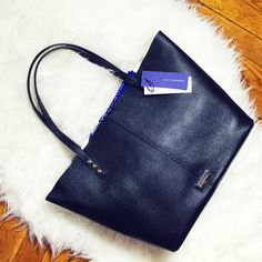 """rebecca minkoff • unlined leather tote condition: new with tags retail: $275 plus tax    slouchy profile with rows of polished studs trim the sides. magnetic top closure.   11""""W x 13.76""""H x 5""""D  top handles with 8.25"""" drop  unlined + dustbag + removable pouch  offers always welcome • bundle to save the most • no trades • ask ?s • happy poshing! Rebecca Minkoff Bags Totes"""