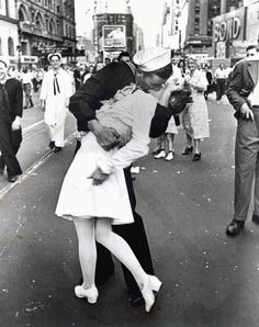 """""""When I have a camera in my hand, I know no fear."""" - Alfred Eisenstaed    VJ Day, The Kiss is still a favorite of mine."""