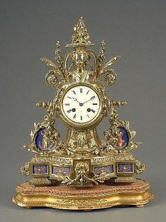 A French porcelain mounted gilt metal mantel clock, the circular white enamelled dial with Roman chapter ring, inscribed 'Henry Marc, Paris', eight day movement, striking on a bell, the case in Louis XVI style and cast with sprays of flowers and fruit with urn and central female mask, the inset 'Sevres' porcelain plaques painted with classical figures and urns on a bright blue ground, on a shaped giltwood base