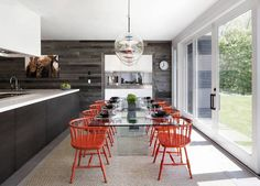 juxtaposition of the #sleek&modern to the old #barnwood You Won't Believe This Homes's Modern, Family-Friendly Makeover