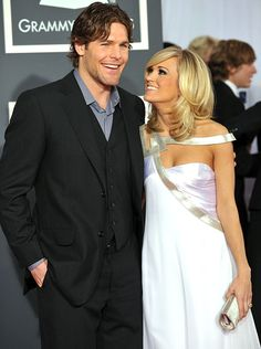 Mike Fisher and Carrie Underwood. He is one of the sexiest hockey players ever.