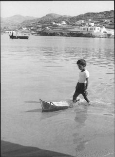 until he's big enough to handle the big boats, he'll practice on the little ones! Mykonos Island, Mykonos Greece, Athens Greece, Santorini, Vintage Pictures, Old Pictures, Greece History, Myconos, Old Time Photos