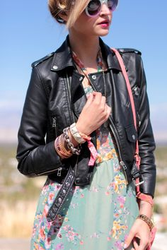 """The leather biker jacket paired with a floral pastel printed dress is a recent trend that will be an """"it"""" outfit for the next season. I love the edgy laidback vibe that this outfit gives off."""