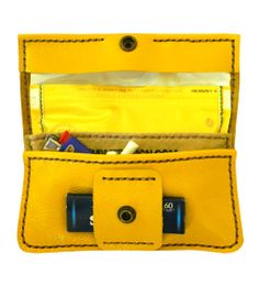 Yellow leather rolling tobacco pouch PERSONALIZE IT. $39.99, via Etsy.