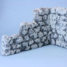 A faux stone wall made from styrofoam bead board with three shades of grey applied to mimic stone. Christmas Village Display, Christmas Villages, Christmas Houses, Victorian Christmas, Christmas Trees, Vintage Christmas, Christmas Ornaments, Faux Stone Walls, Model Village