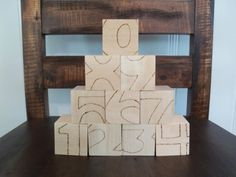 This set of ten wooden blocks is a great help for kids to learn numbers. Custom burned designs are on four sides.