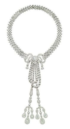 A BELLE EPOQUE DIAMOND NECKLACE, BY CARTIER  The lattice ribbon-style necklace centering upon a stylized bow, suspending rope hoops and two tassel pendants, entirely set with diamonds, the central motif can detach to be worn as a brooch, with additional fitting and screwdriver, mounted in platinum, 1911, 35.0 cm, in navy blue leather fitted Cartier case Signed Cartier, nos. 6312 and 46 (indistinct), with maker's mark for Atelier Henri Picq