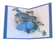 Rotating butterfly pop up card. Butterfly folds flat into center fold of card and rotates as the card opens.