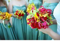 Colorful bouquets with Tiffany blue bridesmaid dresses.