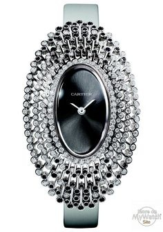 CARTIER - Cartier Libre collection - Model: Baignoire Débordante - Nber of pieces: 50 - White Gold - Diamonds - Black Spinels. The Cartier Libre collection was born of a desire to play with the Maison's signature watch shapes. They are stretched, shrunk and transformed into objects of fantasy with unbridled creative licence. Cartier Libre appeals to the collectionneuse, the figure of the watchmaking collector.