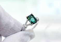 Engagement Ring 2 Carat Green Tourmaline Ring by stevejewelry. $698.00 USD, via Etsy. Does this look teal to you?