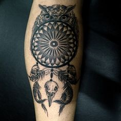 owl skull circle tattoo