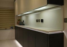 Terra Oak vaneer & white glass doors showing illuminated drawer & base shelf and illuminated handleless rail - See more at: http://www.bravermankitchens.co.uk/kitchens/modern-kitchens/#sthash.MkEBtNXI.dpuf #ModernKitchens #KitchenDesign #BravermanKitchens #Illuminated