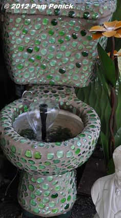 toilet fountain: I like this but would have added more stones and lowered the fountain so that it just slightly disturbed the water in the bowl.