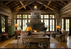Terrific square full log family room.  The simplicity of the room lets the detail of the logs shine through, especially with all of the great windows!  Notice the shed elk sofa table legs.  Big Timber, Montana log home