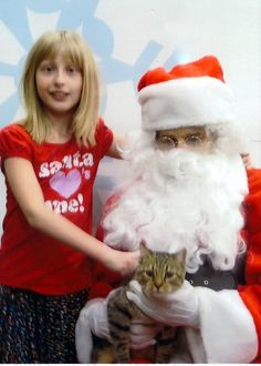 Shelby and Lilly keeping Santa busy!