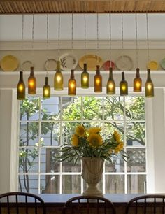 DIY - Make a wine-bottle chandelier. So cool for outside