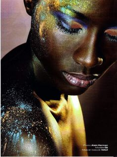 Loose mica pigments dropped or blown onto creamy metallic bronze body paint.  Also some body glitter, particularly on forehead.  A labor-and-makeup-intensive look not representative of this board, but I couldn't resist.  Via Shannon Bradley.
