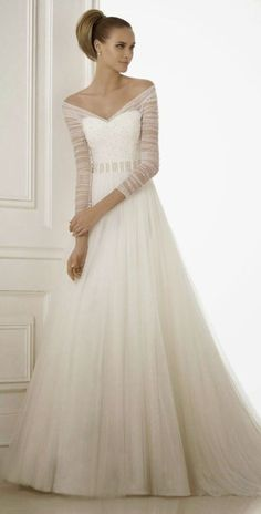 Ball gowns work for brides over 50 too, just take a look at this flowing masterpieces.
