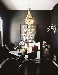 Gorgeous empire chandelier in a dark office