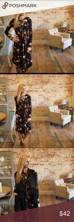 """Black floral long sleeve dress Cozy thick knit long sleeve floral dress, elastic waist, midi length. Modeling size small. 95% polyester 5% spandex, bust laying flat: S 18"""" M 19"""" L 20"""" waist (before stretch) S 12.5"""" M 13.5"""" L 14.5"""" length S 39"""" M 40"""" L 41"""". Add to bundle to save when purchasing two or more items from my closet. RB12751007 Dresses Midi"""