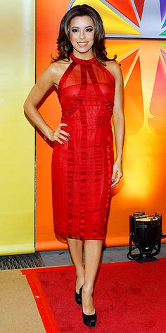 EVA LONGORIA  The actress perfectly pulls off an understated and elegant ensemble – a red Alberta Ferretti halter dress, black platforms and flawless makeup – at the NBC upfronts in N.Y.C.