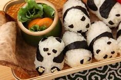 Sushi pandas! I'd feel a little weird popping a panda in my mouth, but hey, they're cute.
