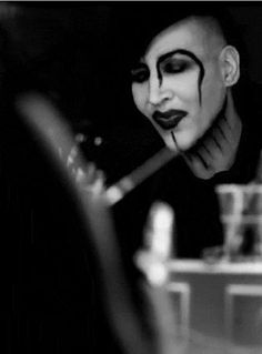 Hey Cruel World Mirror Smiles. I dont know why but some of my favorite pics of Marilyn Manson are of him putting his make up on so beautifully in the mirror #MarilynManson