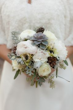 This winter #wedding bouquet is amazing...love the pinecones!  From http://stylemepretty.com/florida-weddings/2012/12/06/outdoor-winter-photo-shoot-from-kristina-grimm-photography/  Photo Credit: http://kristinagphotography.com/  Florals by http://fairbanksflorist.net/