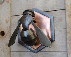 Hexagon bee door knocker.