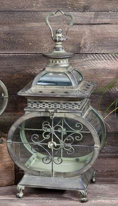 Dress up your outdoor lighting with beautiful old lanterns.  If your lantern is plain, dress it up with paint or stick on jewels.