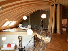 domespace loft--I like how the paper pendant light fixtures are reminiscent of celestial bodies