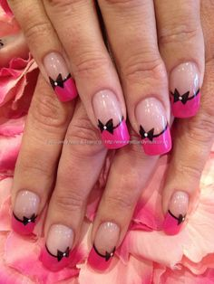 Pink and black nail art on acrylic nails