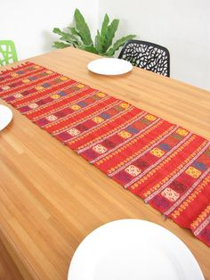Liven up your dining area with these brightly colored handcrafted table runners.  Made on a backstrap loom and each one has unique characteristics.   100% cotton Handwoven on a traditional backstrap loom 70 inches long Available in Red, White, Tan, and Fuchsia Handmade in Chiapas, Mexico $30 chiapasbazaar.com