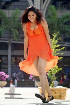 GLAMOUR THUNDER BEAUTY SUNAINA IN ORANGE DRESS DANCING PICS