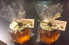 An easy DIY wedding favor project: an E+M Wedding Favors honey favor jar with a custom tag, wrapped in cellophane and tied with raffia. The extra layer of cello adds to the multi-textural effect that makes a favor stand out with some thought and creativity.