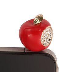 The 3.5mm earphone anti-dust plug stopper features a bite of red apple embellished by shunning clear rhinestones .The lovely headphone jack dust plug  effectively protect the earphone jack from the all-pervasive dust . also decorates your phone with unique stlye.  Four colors is available : Red, Orange, Green and White.